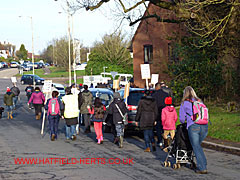 Marchers at the roundabout of the Great North Road, Brocket Road and Stanborough Road