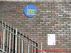 Citizens Advice Bureau logo, notice and stairs